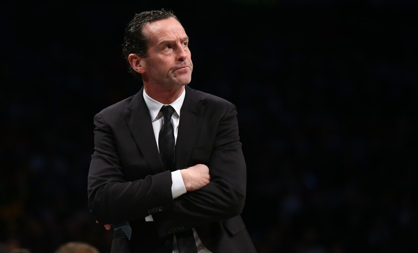 Kenny Atkinson looks on from the Brooklyn Nets bench.