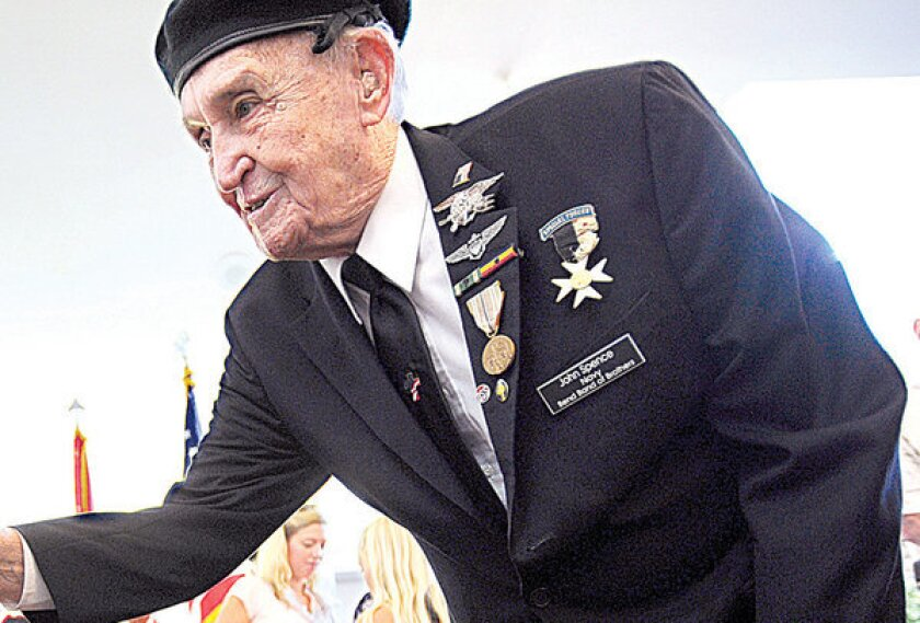 """John Spence, shown in a 2012 photo, served as a combat """"frogman"""" during World War II. He was the first diver to try out a breathing apparatus that sent no bubbles to the surface, which would help swimmers approach their targets without notice. He died Tuesday in Bend, Ore."""
