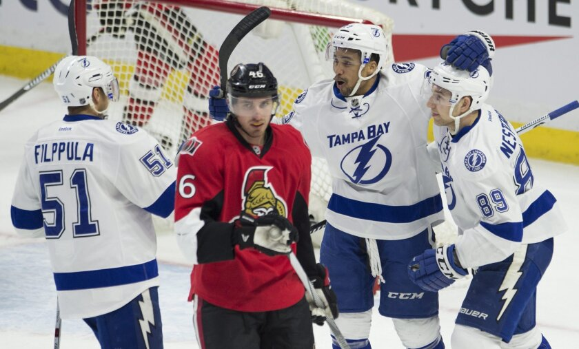 Ottawa Senators defenceman Patrick Wiercioch, center left, skates past Tampa Bay Lightning right wing J.T. Brown, second from right, as he celebrates his first period goal with teammates Nikita Nesterov, right, and Valtteri Filppula during first period NHL hockey action in Ottawa , Canada, Monday,