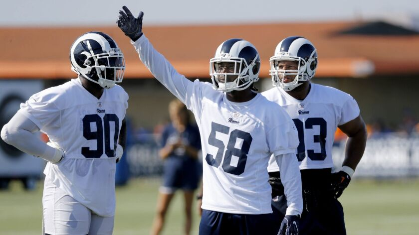 "Rams linebacker Cory Littleton, flanked by defensive linemen Michael Brockers (90) and Ndamukong Suh at practice, says he is aware of outside skepticism about the team's linebackers. ""We can't expect people to expect much out of us, but we plan on proving them wrong,"" he says."