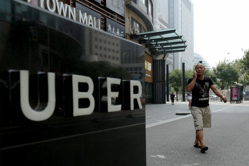 Uber said it was selling its China operations to its chief rival there, Didi Chuxing.