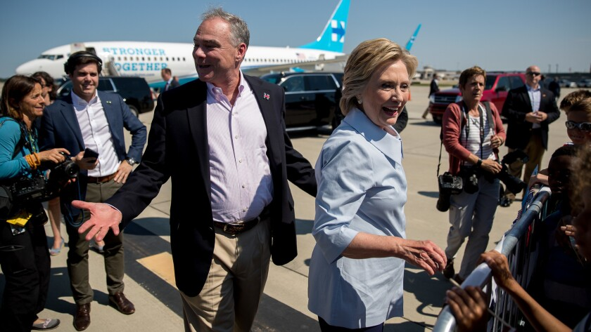 Democratic presidential nominee Hillary Clinton and her running mate Tim Kaine arrive for a Cleveland campaign stop.