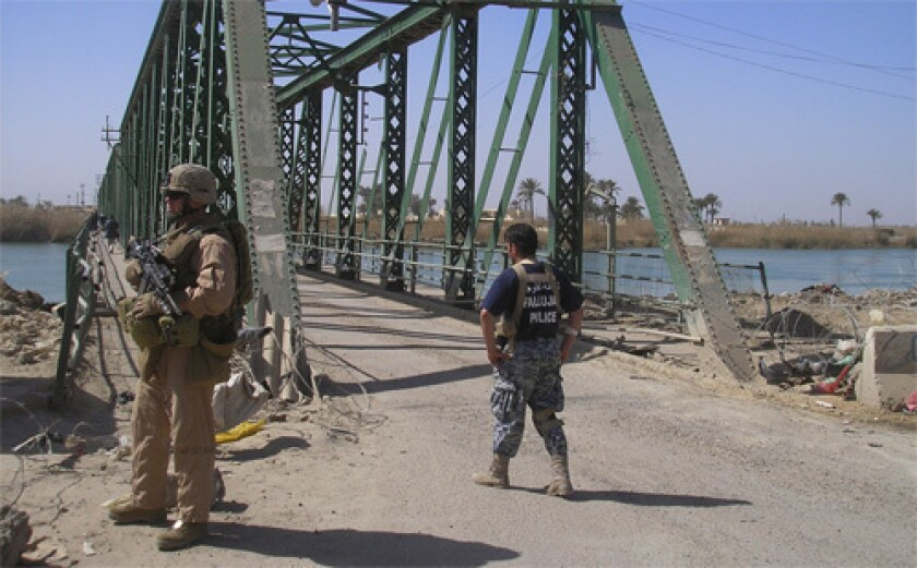 The bridge from which a mob hung the bodies of slain U.S. security workers in 2004 is a key part of Fallouja's recovery. It is to be widened so more people can enter the city.