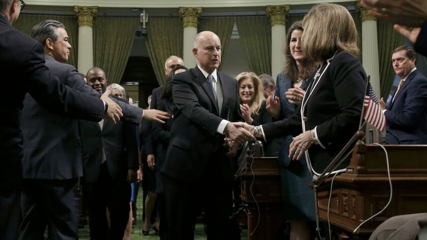 California Gov. Jerry Brown shakes hands with Senate Republican Leader Patricia Bates, of Laguna Nigel, as he walks to the podium to deliver his annual State of the State speech.