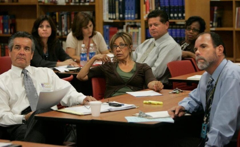 """Sweetwater Union High School District principals and administrators are briefed before visiting English classes at Castle Park High School, which uses a """"rhetorical approach"""" to the subject."""