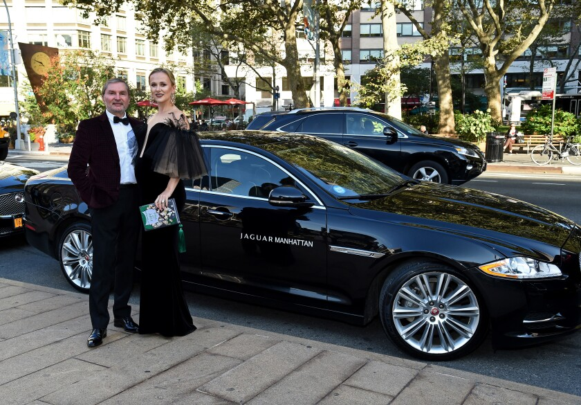 Svitlana Flom and her husband, Gary, pose at the Metropolitan Opera House in New York City on Sept. 26, 2016.
