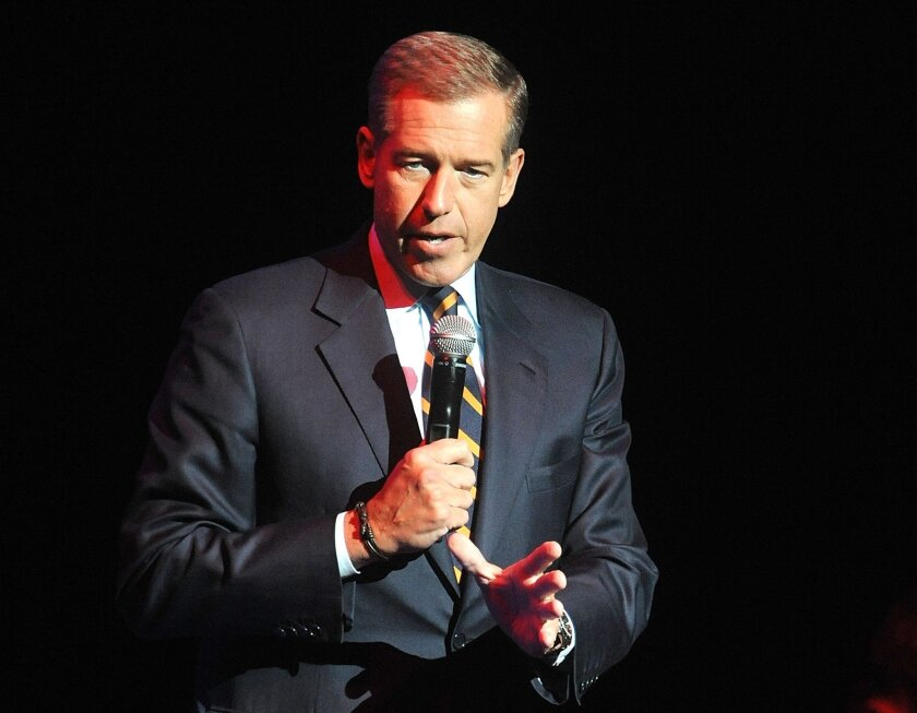 FILE - In this Nov. 5, 2014, file photo, Brian Williams speaks at the 8th Annual Stand Up For Heroes, presented by New York Comedy Festival and The Bob Woodruff Foundation in New York. Williams will return to the air on Sept 22, 2015, as part of MSNBC's coverage of Pope Francis' visit to the United States. (Photo by Brad Barket/Invision/AP, File)