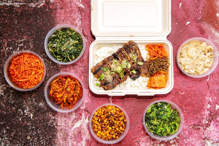 Several side dishes accompany a main dish of galbi.