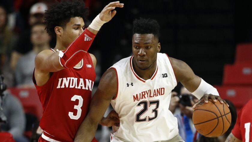 Maryland forward Bruno Fernando tries to drive against Indiana forward Justin Smith (Patrick Semansky / AP)