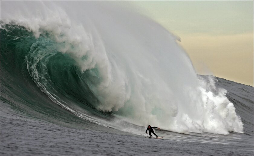 A surfer near Todos Santos Island, about 10 miles off the coast of Ensenada, in a 2005 photo.