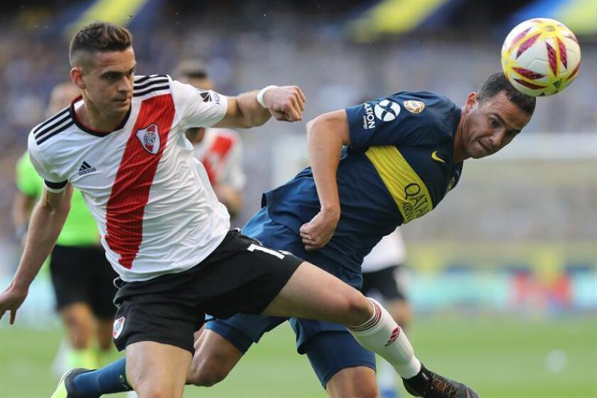 The River Plate player Rafael Santos Borre (L), fights for the ball with Agustín Almendra, from Boca Juniors, Sept. 23, 2018,at the Bombonera stadium, in Buenos Aires (Argentina). EPA-EFE FILE/Juan Ignacio Roncoroni