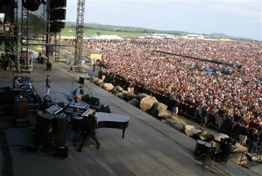 In an Aug. 14, 2004, file photo, Phish performs the Phish Festival in Coventry, Vt., which the group called their final performance. Fresh off a nearly five-year break, the family reunion starts Friday, March 6, 2009. (AP Photo/Alden Pellett, File)