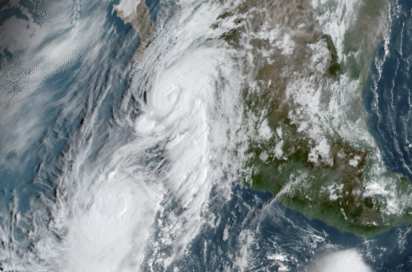 A satellite image shows Hurricane Lorena and Tropical Storm Mario