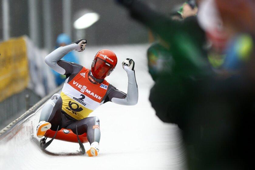 Germany's Felix Loch celebrates after winning the men's luge World Championships race in Koenigssee, Germany, Sunday, Jan. 31, 2016. (AP Photo/Matthias Schrader)