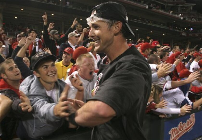 Cincinnati Reds' Drew Stubbs wears goggles as he celebrates on the field with fans after the Reds defeated the Houston Astros 3-2 in a baseball game to clinch the NL Central, Tuesday, Sept. 28, 2010, in Cincinnati. (AP Photo/Tom Uhlman)