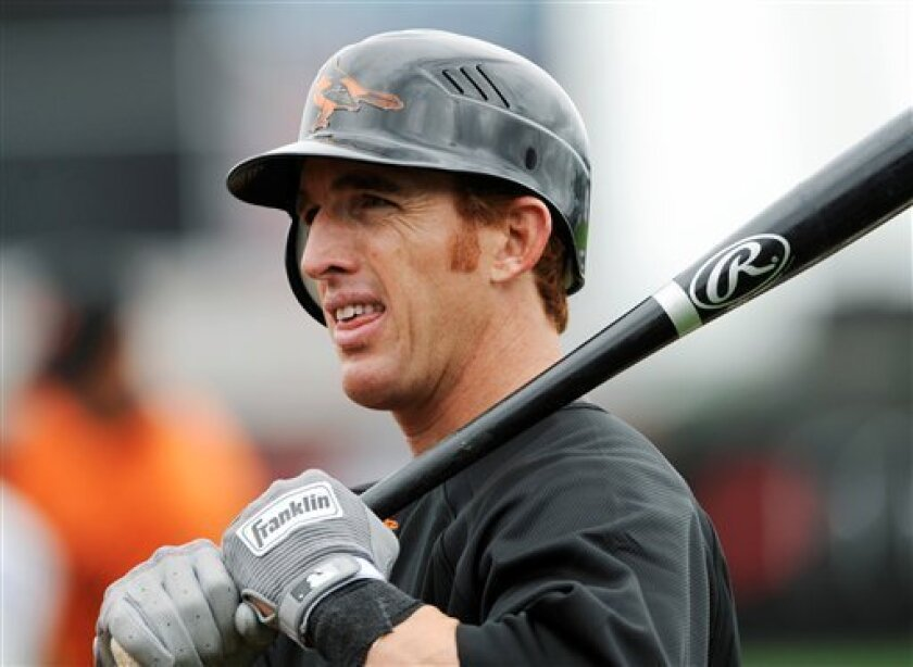 Baltimore Orioles outfielder Jay Gibbons waits to hit in the batting cage during spring training baseball practice in Fort Lauderdale, Fla. in this February file photo. Major League Baseball has put the suspensions of Baltimore's Jay Gibbons and Kansas City's Jose Guillen on hold for 10 days.