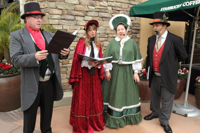 Carolers greeted shoppers at the Flower Hill Mall in Del Mar