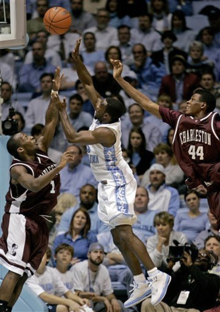 North Carolina's Ty Lawson, center, drives to the basket as College of Charleston's Donavan Monroe (1) and Antwaine Wiggins (44) defend during the first half of an NCAA college basketball game in Chapel Hill, N.C., Wednesday, Jan. 7, 2009. (AP Photo/Gerry Broome)