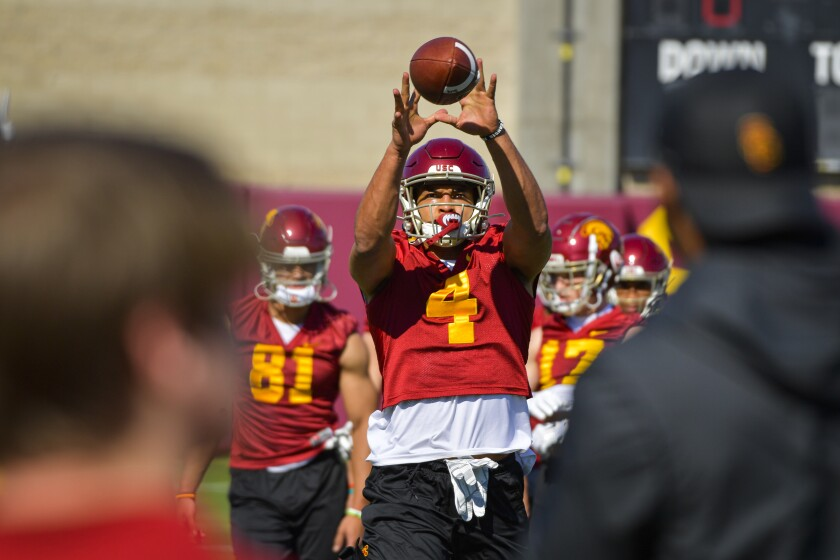 USC wide receiver Bru McCoy catches a pass during a practice session.