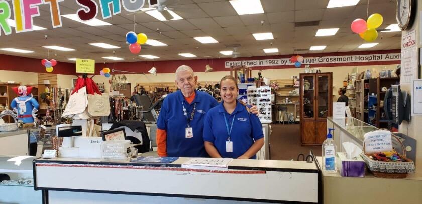 Grossmont Healthcare Hero award winner for 2020 George Bartz (left) is shown with fellow volunteer Valerie Viberos at the Sharp Grossmont Hospital Volunteer Auxiliary's offsite Thrift Korral resale boutique in La Mesa.