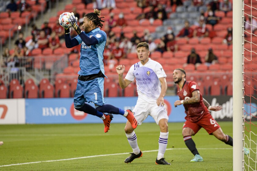 Orlando City SC goalkeeper Pedro Gallese (1) makes a save against Toronto FC during first-half MLS soccer match action in Toronto, Saturday, July 17, 2021. (Chris Katsarov/The Canadian Press via AP)