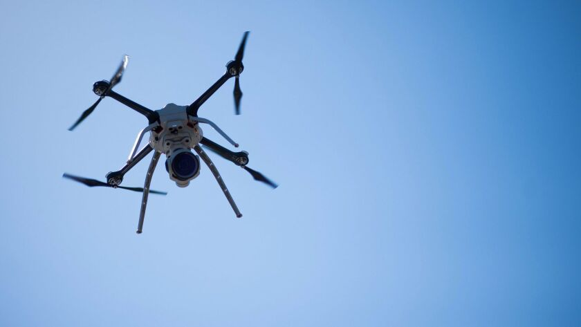 A 14-person brain trust is urging the Federal Aviation Administration to expedite the approval of commercial drone projects.
