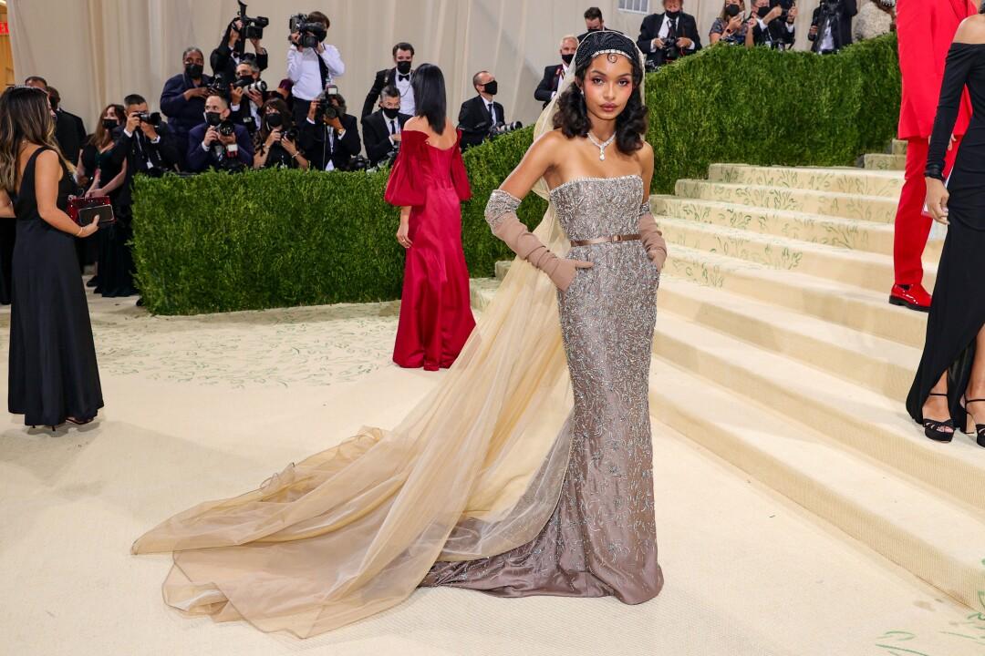A woman in a metallic mesh dress.