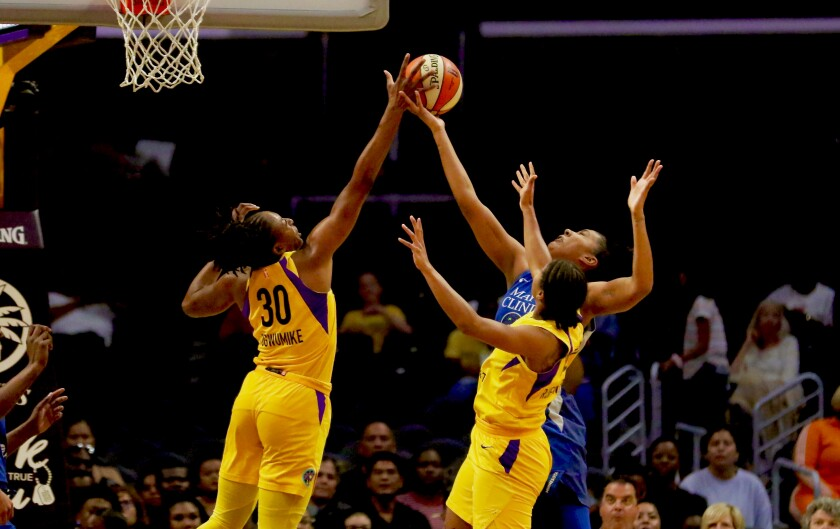 Sparks forward Nneka Ogwumike (left) blocks a shot by Minnesota's Damiris Dantas during the first half of Tuesday's game.
