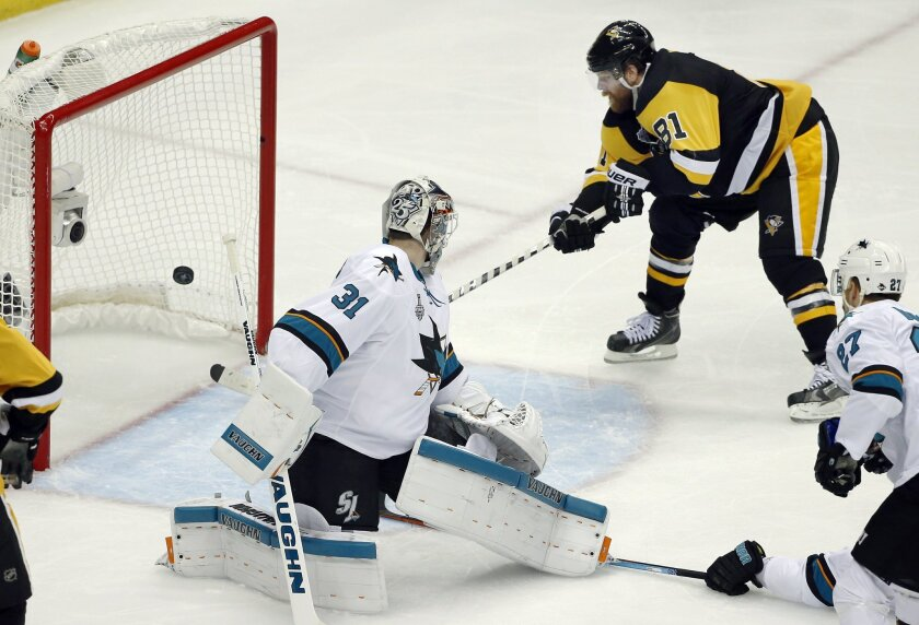 Pittsburgh Penguins' Phil Kessel (81) scores a goal behind San Jose Sharks goalie Martin Jones (31) during the second period in Game 2 of the NHL hockey Stanley Cup Finals on Wednesday, June 1, 2016, in Pittsburgh. (AP Photo/Gene J. Puskar)