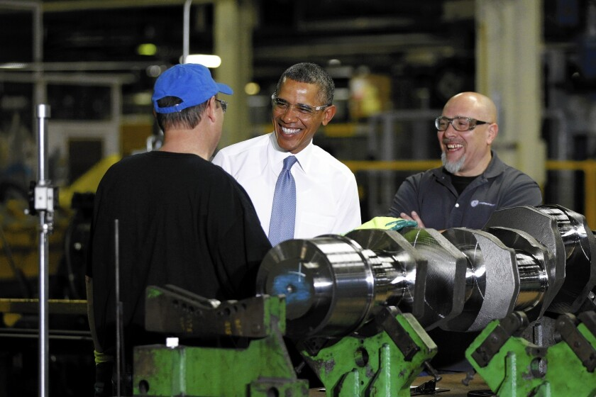 President Obama visits a General Electric plant in Waukesha, Wis., where he ordered a review of federal job training programs.
