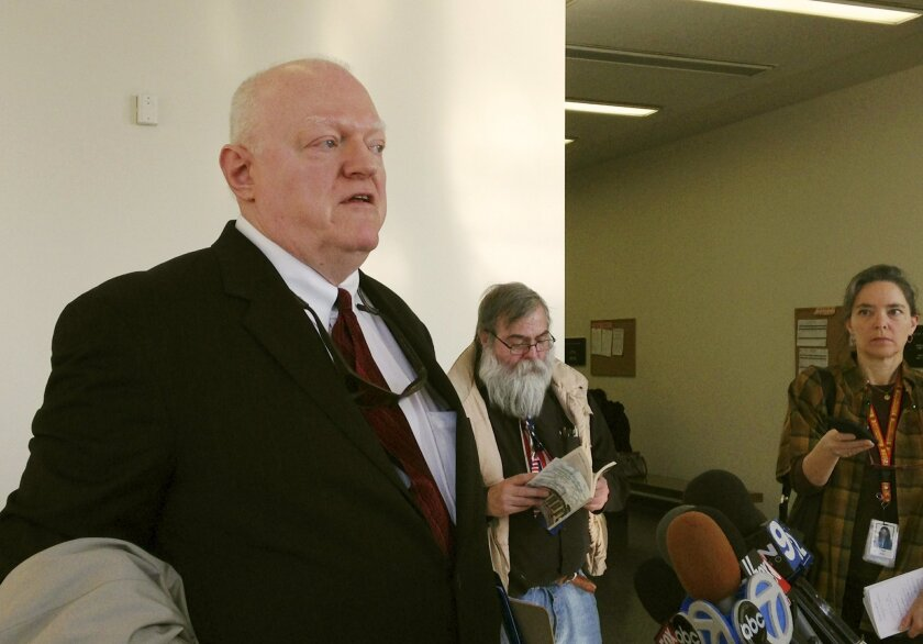 Lawrence Joyce, a pharmacist and lawyer from Illinois, speaks to reporters after a court hearing Friday, Feb. 19, 2016, in Chicago. Joyce said Friday he has filed a lawsuit challenging Texas Republican candidate Ted Cruz's eligibility to be put on the Illinois ballot for the March 15 primary. Lawsu