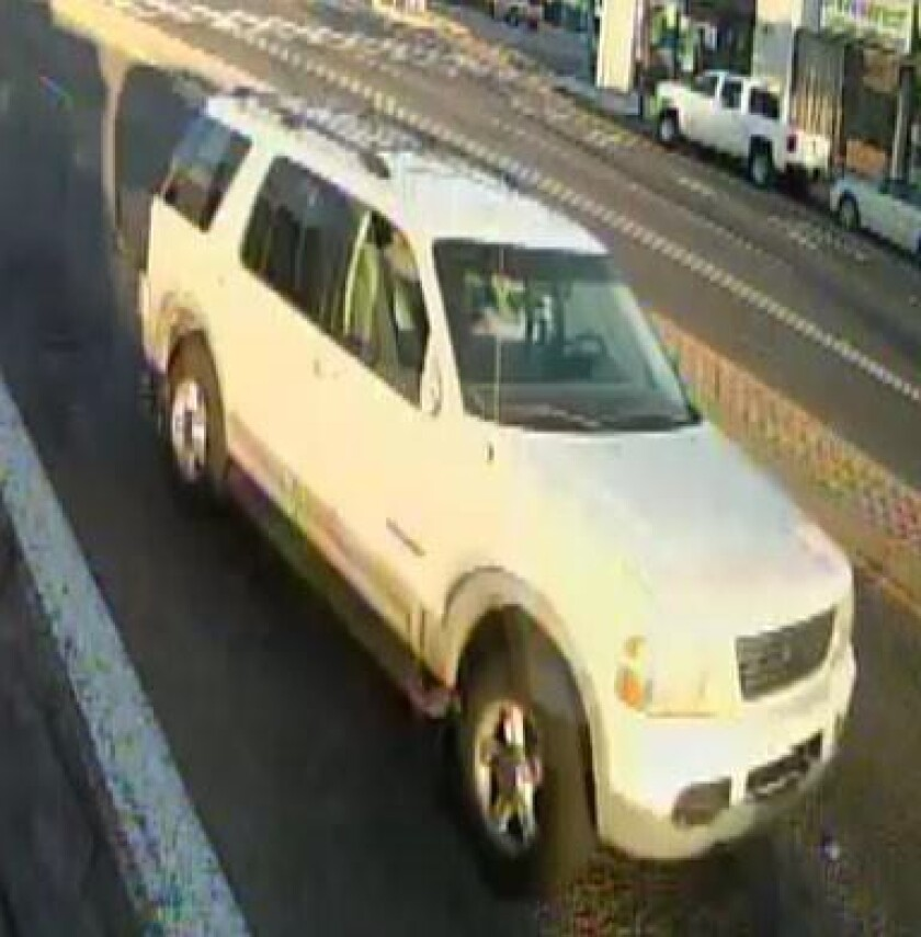 San Diego police said this white Ford SUV missing its passenger side mirror struck and gravely injured a man May 5 on El Cajon Boulevard and Copeland Avenue.
