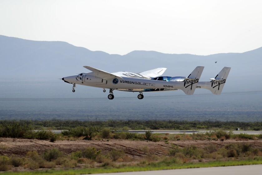 FILE - In this Sunday, July 11, 2021 file photo, the craft carrying Virgin Galactic founder Richard Branson and other crew members takes off from Spaceport America near Truth or Consequences, N.M. Virgin Galactic plans to launch three Italian researchers to the edge of space in a few weeks, even as its previous flight with founder Richard Branson is under investigation by the Federal Aviation Administration. (AP Photo/Andres Leighton)