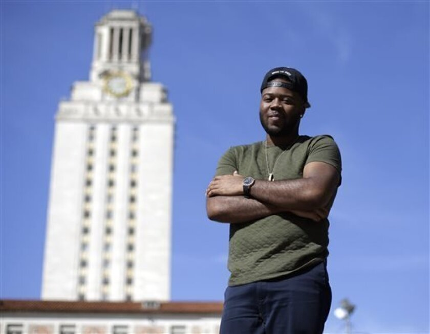 In this March 5, 2013 photo, University of Texas senior Bradley Poole, 21, poses for a photo on the campus in Austin, Texas. Poole, an advertising major, became president of the school's Black Student Alliance, seeking camaraderie after noticing he often was the only African-American in his classes