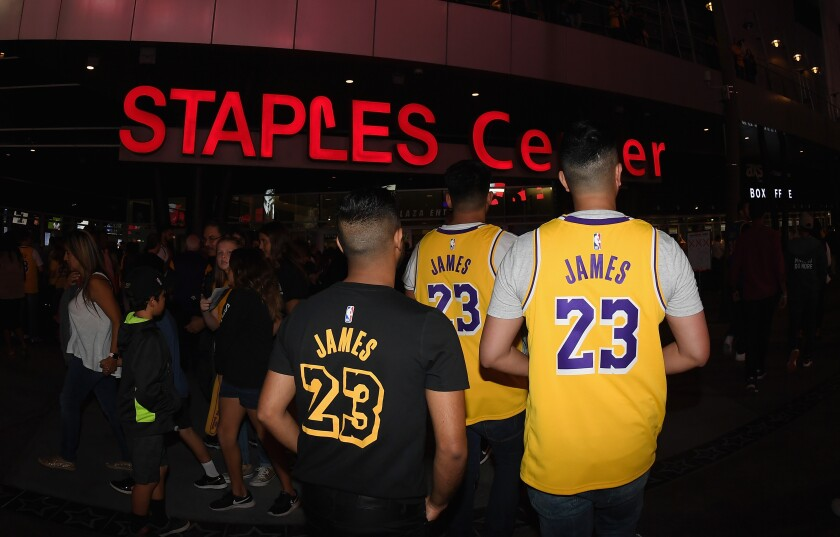Fans line up outside of Staples Center before a Lakers game.
