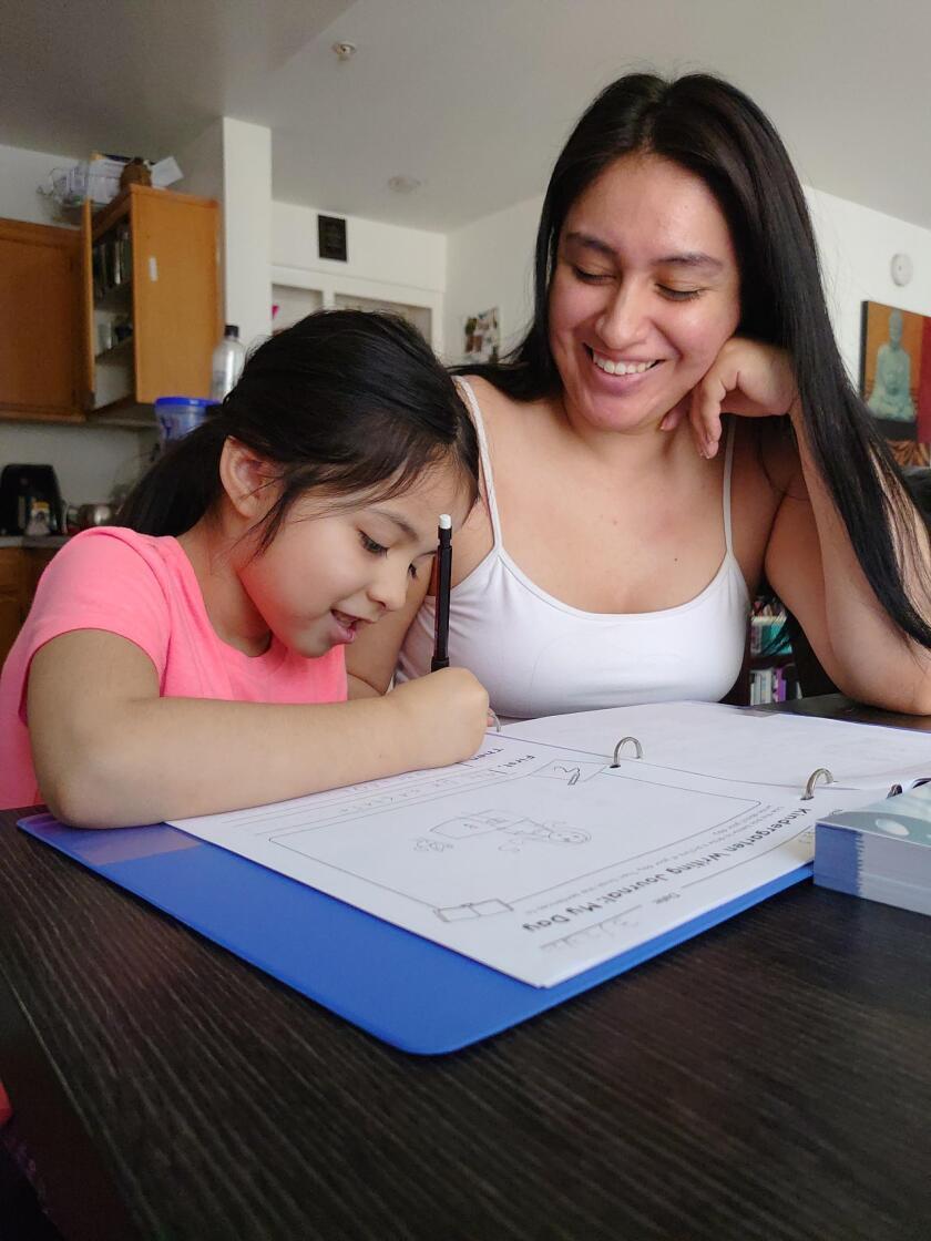 UCLA student Zuleika Bravo with daughter Iris Jimenez