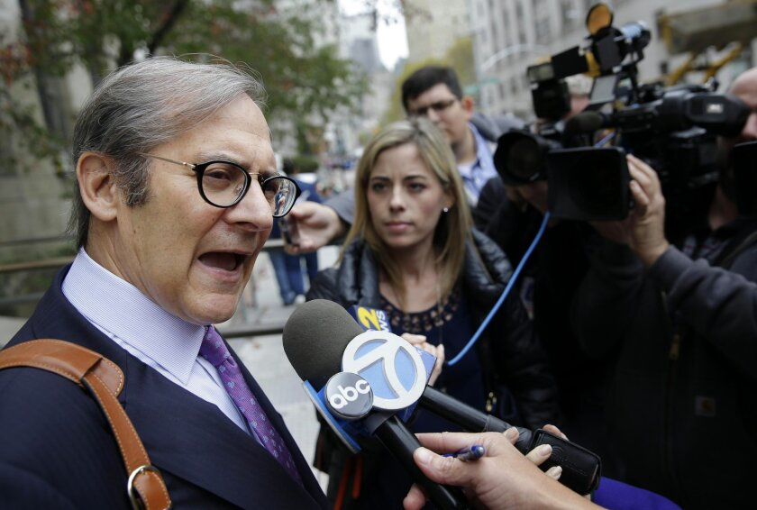 Attorney Robert Gottlieb, left, speaks to reporters in New York, Monday, Nov. 2, 2015. Gottlieb is representing Roderick Covlin who has been arrested on a murder charge in a case full of dramatic twists: his wife's death initially seen as accidental and later ruled a homicide, an exhumed body, a di