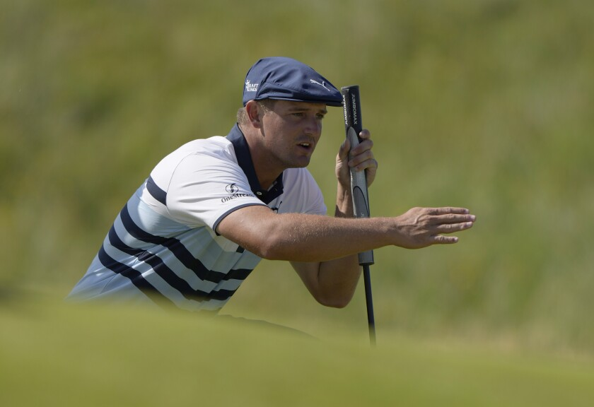 FILE - In this July 17, 2021, file photo, United States' Bryson DeChambeau gestures as he lines up his putt on the 2nd green during the third round of the British Open Golf Championship at Royal St George's golf course Sandwich, England. DeChambeau has tested positive for COVID-19 before leaving the United States for the Olympics and will miss the Tokyo Games. He'll be replaced by Patrick Reed. (AP Photo/Alastair Grant, File)