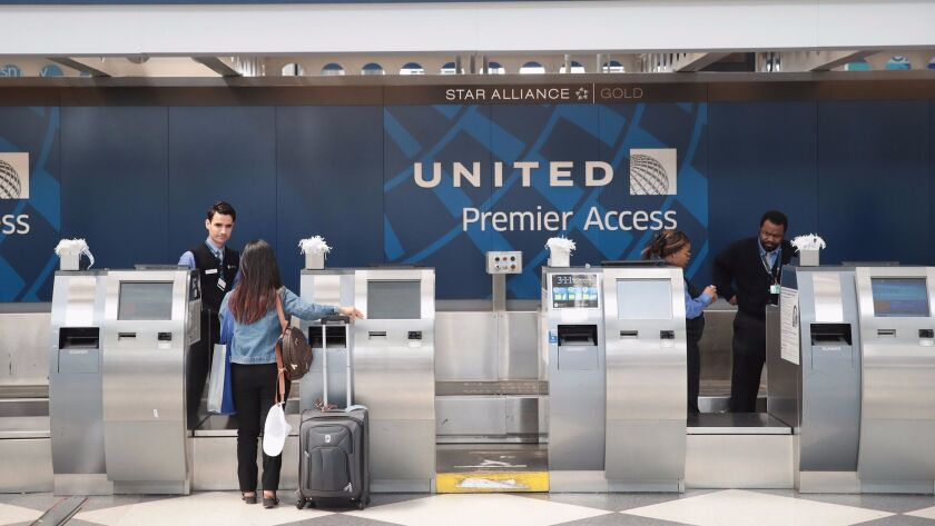 Passengers arrive for flights at the United Airlines terminal at O'Hare International Airport on Wednesday in Chicago.