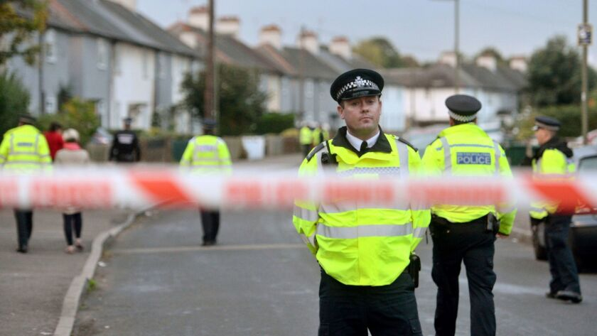 Police officers work near a property in Sunbury-on-Thames, southwest London, on Sept. 16 as part of the investigation into the Parsons Green bombing.