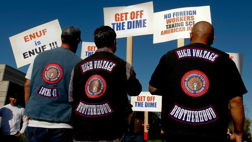International Brotherhood of Electrical Workers members rally in February 2015 at the Southern California Edison offices in Irvine to protest Edison's plans to lay off hundreds of employees.