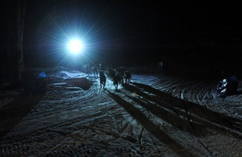 Four-time Iditarod champion Martin Buser arrives first at the Yukon River in Anvik, Alaska during the Iditarod Trail Sled Dog Race, early Friday, March 8, 2013. (AP Photo/Anchorage Daily News, Bill Roth) LOCAL TV OUT (KTUU-TV, KTVA-TV) LOCAL PRINT OUT (THE ANCHORAGE PRESS, THE ALASKA DISPATCH)