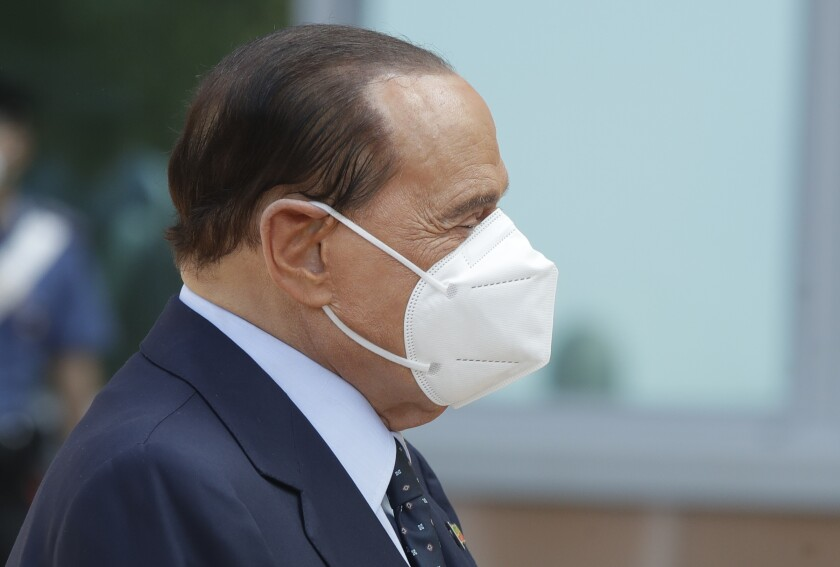 Italian former Premier Silvio Berlusconi wears a face mask as he leaves the San Raffaele hospital in Milan, Italy, Monday, Sept. 14, 2020. Berlusconi had been admitted to the hospital as a precaution to monitor his coronavirus infection after testing positive for COVID-19. (AP Photo/Luca Bruno)