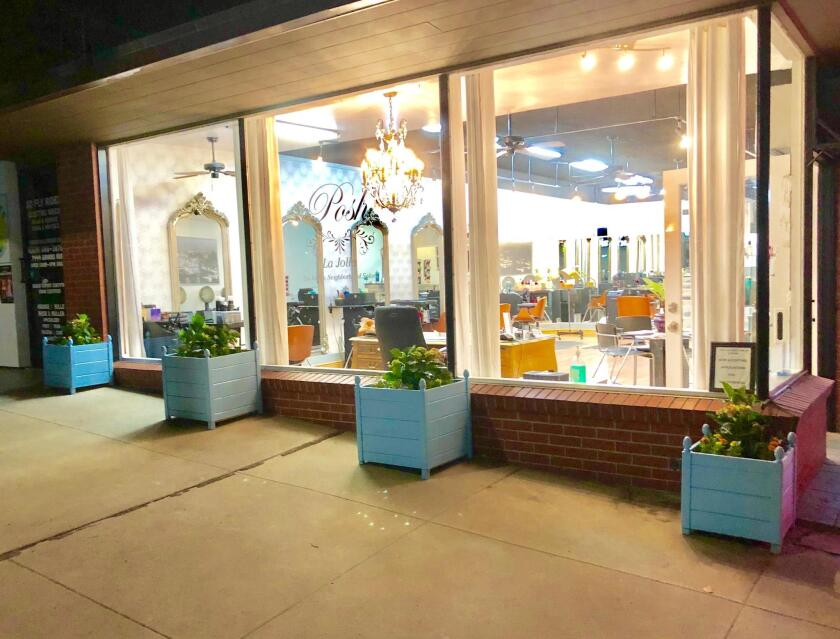 AFTER planters were placed in front of Posh La Jolla salon on Girard Avenue.