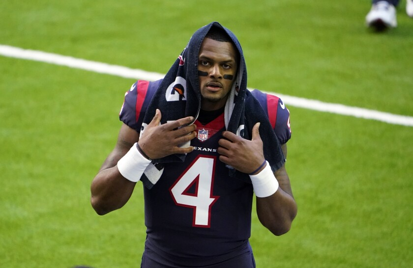 Houston Texans quarterback Deshaun Watson walks off the field in game against Tennessee Titans in Houston Friday.