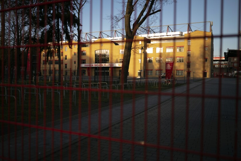 Gates are closed at the stadium 'An der alte Foersterei' where the German Bundesliga soccer match 1. FC Union Berlin against FC Bayern should have taken place in Berlin, Germany, Saturday, March 14, 2020. After the other four main leagues in Europe had already been suspended, the German soccer authorities gave in and suspended all Bundesliga games because of the novel coronavirus outbreak on Friday. For some, especially older adults and people with existing health problems, it can cause more severe illness, including pneumonia.(AP Photo/Markus Schreiber)