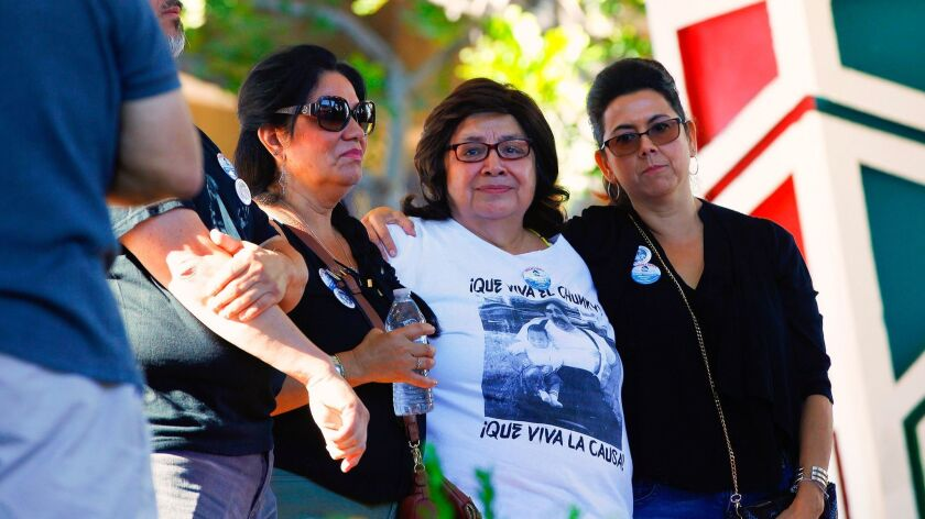 Chunky's widow, Isabel (center) was surrounded by family and friends as she paid tribute honoring her late husband, Ramon Sanchez on Sunday at Chicano Park for the Celebration of Life honoring Sanchez.