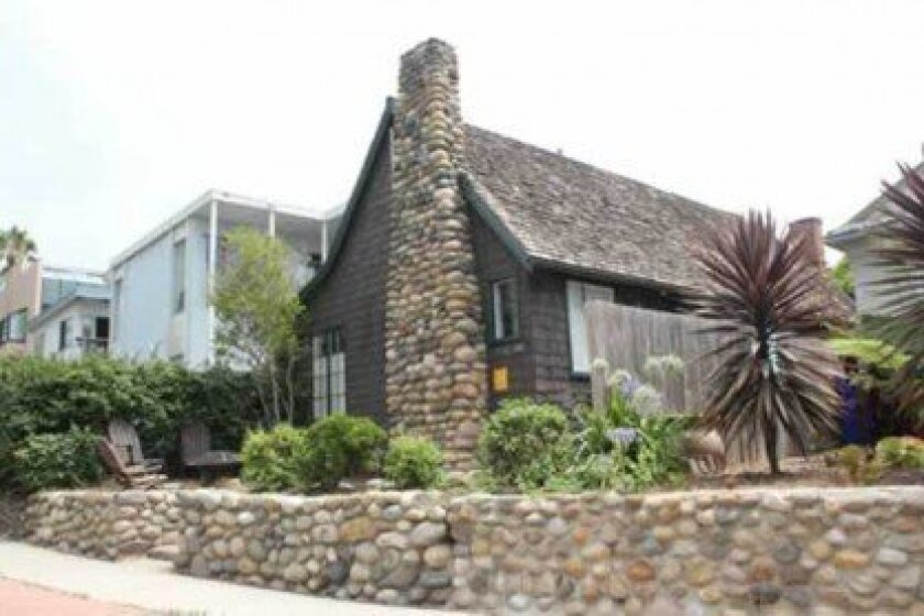The la Jolla Historical Society hopes to thwart a developer's plans to demolish these adjoining 1930s WindanSea cottages with a last-minute appeal to the city's Historical Resources Board. File Photo