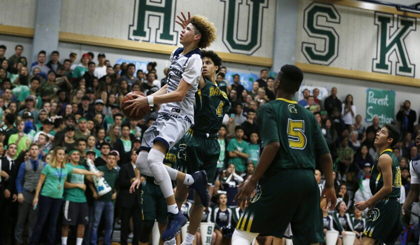 Chino Hills' LaMelo Ball (1) drives to the basket against Damien's Ashton Sharma (4) and Ezekiel Alley (5) in the second half in Chino Hills on Jan. 10.
