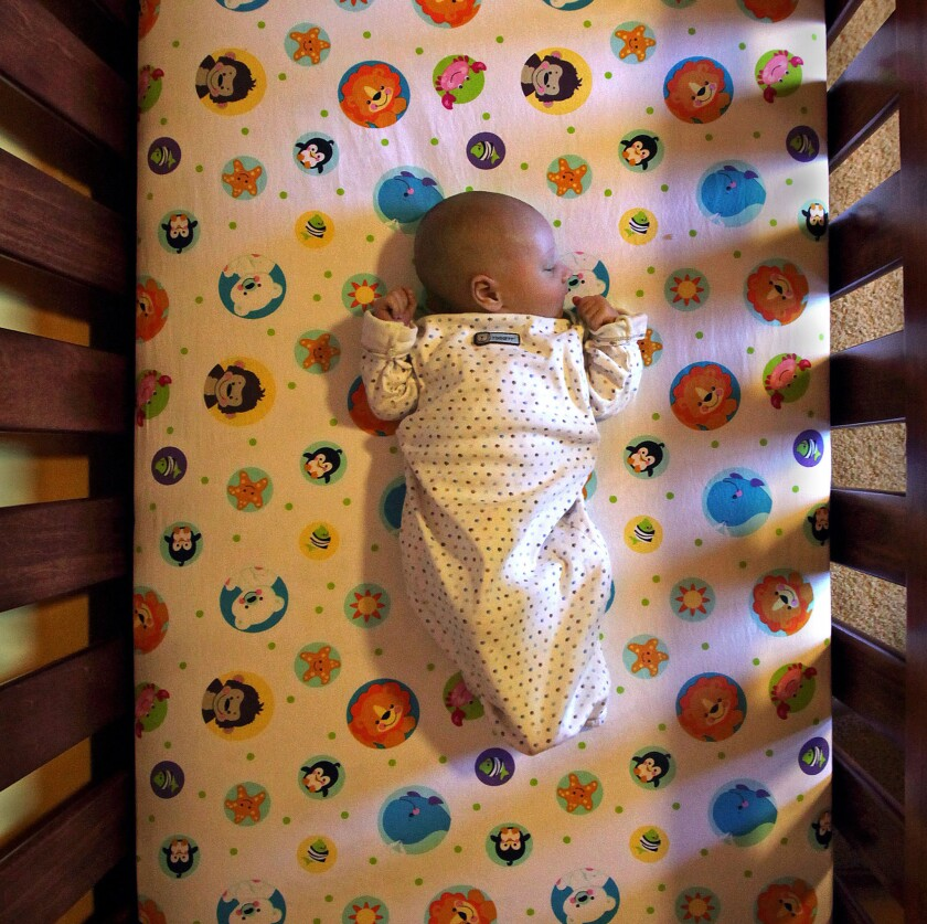 A baby sleeping in a crib.